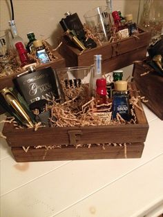 The groomsmen gift boxes personalized with the first name letter. Stuffed with mini liquor bottles, personalized flasks, a 50cal bullet bottle opener, and a pint glass.