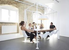 Swing Table with hanging chairs by Duffy London - we need one of these at VIA