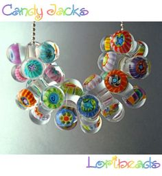"""These murrini tri-bead """"Candy Jacks"""" by Lori Peterson (tutorial at Eva Cadkova's http://eskiebeads.com) are a perfect example of why I NEED to learn lampworking."""