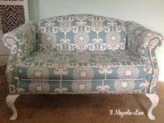 How to change a love seat from lame to lovely by reupholstering it yourself.