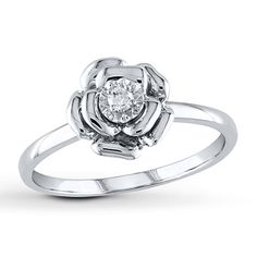 The timeless allure of the rose is beautifully captured in this sterling silver ring for her.