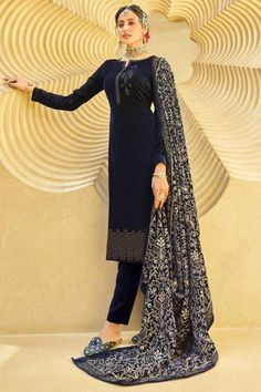 Bright and appealing, this navy blue velvet trouser suit which will certainly make you rule to the party. This round neck and full sleeve suit accentuated with stone work. Teamed up with santoon cigarette pants in navy blue color with navy blue velvet dupatta. Cigarette pants is plain. Dupatta designed using thread and stonework. #trousersuit #salwarkameez #malaysia #Indianwear #Indiandresses #andaazfashion Blue Trousers, Trouser Suits, Indian Attire, Indian Ethnic Wear, Asian Suits, Kurta Cotton, Navy Blue Color, Teal, Velvet Pants