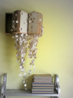 10 DIY Wall Decor Ideas, Recycled Crafts and Cheap Decorations Adding Interest to Empty Walls is part of Book wall art - DIY wall decor ideas are cheap and creative alternative ways of blank wall decoration Old Book Art, Old Books, Vintage Books, Altered Books, Diy Wanddekorationen, Easy Diy, Book Wall, Book Sculpture, Tablescapes