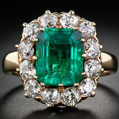 This classic antique emerald and diamond ring shines brightly with a vibrant, rich green, Colombian old-mine (Muzo) Emerald weighing carats. The gem is wreathed by twelve sparkling old mine-cut diamonds set in 18 karat yellow gold. Circa 1890 with wo Emerald Jewelry, Gems Jewelry, I Love Jewelry, Jewelery, Fine Jewelry, Emerald Rings, Emerald Diamond, Diamond Rings, Antique Rings