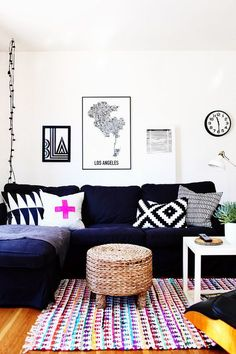 Black and white living room with one vibrant purple pillow