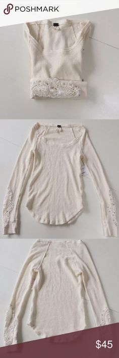 """Free people synergy thermal ivory top shirt This is a lovely top by We the Free called the Synergy Cuff Thermal. It is ivory and has crochet details on the sleeves. It is a waffle fabric and a size S. Nwt. Retails for $68. Machine wash, lay flat.  See additional listing for defect photos  Shoulder to shoulder: 12.5""""-17"""" Arm pit to arm pit: 12""""-22.5"""" Waist: 11 1/4""""-23"""" Shoulder to hem: 19""""-22"""" Sleeves: 23.5"""" Free People Tops Tees - Long Sleeve"""