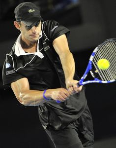 Pin for Later: We've Got Nothing but Love For These Ace Tennis Looks  Andy Roddick is one of the most beloved tennis players. Fans all over the world tried to capture his look by wearing his signature Lacoste hat.
