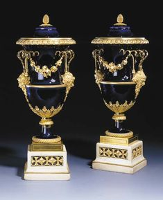 A PAIR OF LOUIS XVI ORMOLU-MOUNTED SÈVRES (HARD PASTE) BEAU BLEU PORCELAIN VASES AND COVERS  Circa 1785, the covers with gilt interlaced L marks and gilder's v.d. of Vandé, the ormolu mounts attributed to Pierre-Philippe Thomire  Of slender campana form with gilt lines to the top rim, shoulder and footrims, the cast ormolu handles with satyr's masks and foliage, the spirally cast horns suspending tasselled grapevine swags, the lower part with radiating acanthus leaves and vine...