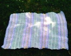 Get creative with the yarn and colors for this easy crochet pattern.  A V-Stitch Baby Afghan makes a fantastic gift and is sure to become a keepsake.