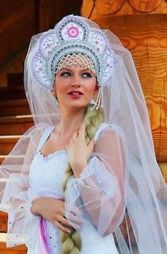 "Russian wedding in the folk style. A bride in the national headdress ""Kokoshnik"" with a veil. #bride #Russian #weddings"