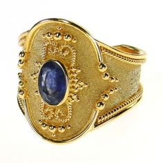 Damaskos Broad Martile Sapphire Ring, 18k Gold and a Sapphire, Emerald or Tourmaline. http://www.athenas-treasures.com/damaskos-broad-martile-sapphire-ring/.  This and more handmade Greek jewelry at Athena's Treasures: www.athenas-treasures.com