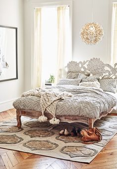 Wooden touches add a vintage yet country finish to bedroom space.