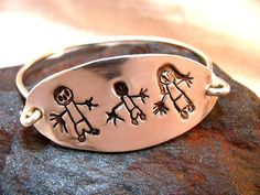 your child's drawings or handwritten note made into jewelry. love this idea! <--- for me, but great gift for grandma, too!