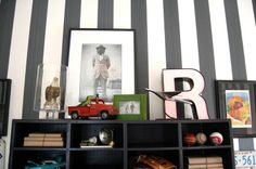 Boys room - hmm black and gold for his fave team on one wall?