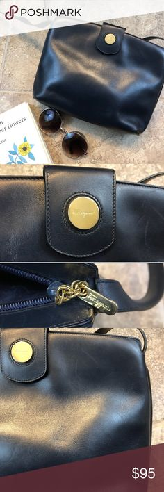 Vintage Ferragamo Crossbody Simple. Classic. Stylish. This bag is perfect for the minimalist girl. It fits so much with its two major pockets and one small inside one. It has a magnetic closure that closes off all of them and also an adjustable strap. The outside of the navy leather bag, to the right of the magnet, has a few scratches and on the inside there are a few more. Completely unnoticeable when worn but something to take note of. Navy blue with gold hardware. Salvatore Ferragamo Bags…