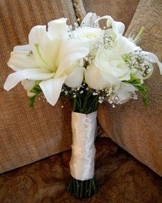 white cream bouquet | We did a very classic all white bouquet with roses…