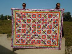 Lazy Sunday, another pattern from Bonnie Hunter.  I did it when it was a mystery in Quiltmaker, spring 2013.  The happy owners are my trusty quilt holders, my daughter Rachel and her husband Shawn.