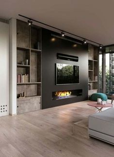 Modern and attractive TV wall design. kamin Modern and attractive TV wall design. Dark Living Rooms, Living Room With Fireplace, Living Room Colors, Living Room Paint, New Living Room, Living Room Modern, Living Room Decor, Modern Wall, Living Room Lighting Design