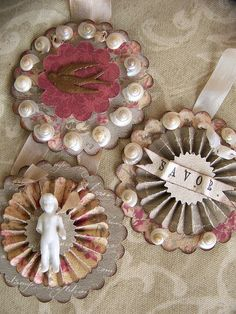 Layered paper rosette ornaments~ by QueenBe1, via Flickr