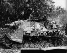 A Sturmpanzer IV from Sturmpanzer-Abteilung 217 during the Battle of the Bulge, probably in the area of Saint- Vith.