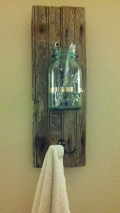 Mason jar bathroom vanity. Toothbrush holder and towel rack.  I am sure I could make this!  It could also be used in the Kitchen.