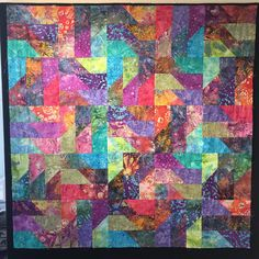 Raquel Carlson made this batik scrap quilt in one evening and the next day. She's in love with the  @AccuQuilt GO! Chisel Die. Also available in GO! Qube die sets!