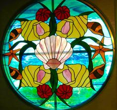 Circular Shell and Sea Horse porthole insert. J&M Stained Glass North Myrtle Beach, South Carolina