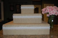 stacked square cupcake tower with burlap and lace (sub lace for homemade paper or nothing with more decorated cupcakes)