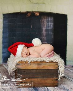 newborn christmas pictures by the fireplace