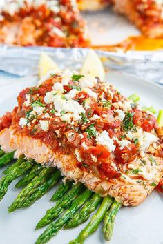 Salmon in a Tomato and Feta Sauce (aka Salmon Saganaki) Recipe : Salmon baked in a tasty tomato and feta sauce with a hint of fennel and plenty of fresh herbs! Best Salmon Recipe, Baked Salmon Recipes, Fish Recipes, Seafood Recipes, Dinner Recipes, Cooking Recipes, Healthy Recipes, Greek Recipes, Salmon Dishes
