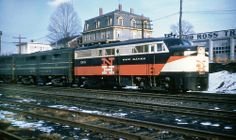 New Haven Railroad DER-2a ALCO FA-1 locomotive # 0410, followed by DER-2c ALCO FB-2, plus another B-unit, is seen leading a freight train on the mainline at an unknown location, mid 1950's, Mac Seabree Collection
