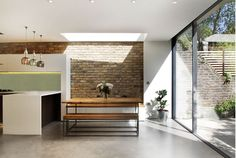 Skylight, materials, continuity with exterior. Bench. Concrete floor?