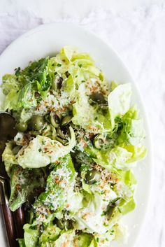 Honey apple cider vinaigrette with castelvetrano olives, manchengo cheese and crisp butter lettuce. Simple ingredients with big flavor.
