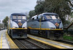 Two Amtrak Capital trains meet at Davis, California, on a rainy March 14, 2006. CDTX EMD F59PHI Nos. 2001 and 2013 power the trains.