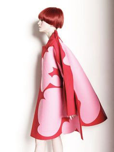 Coat  by Comme Des Garcons.