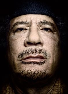 """Muammar Gaddafi by Platon  http://www.platonphoto.com/  Three inches from one of the most notorious dictators in history, the photographer Platon focused tightly on the black eyes glaring at him through his lens. """"There was nothing in them,"""" he said. """"It's like his soul had been scooped out of his head and taken away."""""""
