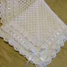 """Crochet Baby Blanket Afghan White Christening, Baptism, Granny Square Baby Blanket, Girl, Boy    Crochet granny square baby blanket. Can be given as a baby shower gift or new mommy.  This beautiful hand crocheted granny square baby blanket is made of 100% soft baby yarn. It is made out of very good high quality yarn.   Beautiful hand crochet baby blanket in white with crochet lacey edging, woven white satin ribbon.   The blanket measures 34"""" inches by 34"""" inches   Perfect gift for n..."""