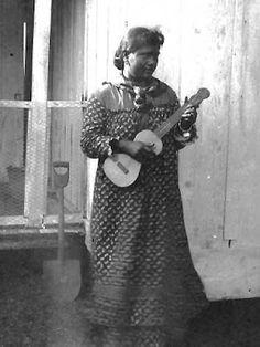 Really vintage ukulele lady -- about 1900. Visit shops that have vintage portraits of old Hawaii.