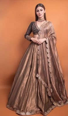 Diva Charm : Mouni Roy makes a ravishing statement in a black-copper embroidered lehenga from Vvani by Vani Vats . WhatsApp us now for personal shopping experience! Party Wear Indian Dresses, Indian Gowns Dresses, Indian Bridal Outfits, Party Wear Lehenga, Indian Fashion Dresses, Dress Indian Style, Indian Designer Outfits, Indian Wear, Pakistani Outfits