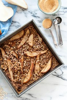 Juicy pears and crunchy pecans come together to create a filling and easy baked oatmeal. Vegan and gluten free.// @TheFrostedVegan
