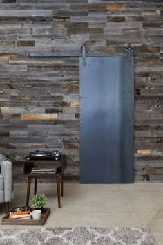 industrial panel sliding door on old wood wall
