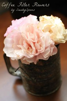 Coffee Filter Flowers - Easy DIY for fun coffee filter flowers. Change the edge you use and get all different kinds! Cute and easy. For a dollar you can make over a dozen flowers!