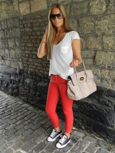 Reddish coral skinnies, a plain white tee, and Black Converse.