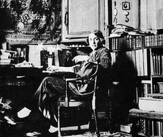 Vita Sackville-West in 1939, in her study at Sissinghurst. Note the photograph of Virginia Woolf on her desk.