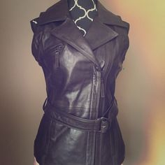 🎉HOST PICK🎉NWT ELIE TAHARI Lamb Leather Vest You will love this gorgeous and brand new with tags chocolate brown lamb leather vest. 100% authentic. Can provide more pictures upon request! Tahari Jackets & Coats Vests