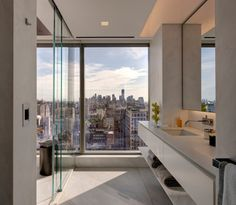 Name: luxury NYC apartment Location: floor overlooking Madison Square Park What I like about: Can't find the location and designer, but really like the simple design of the commode, the separation of the glass.