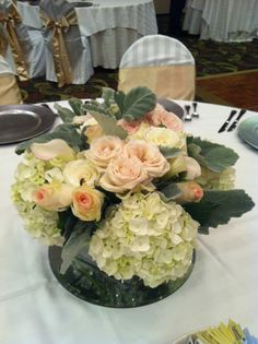 A beautiful peach and white arrangement from Fields in Bloom