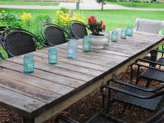 outdoor garden weathered long rectangular farmhouse table Maybe could use the old doors cut to make this?