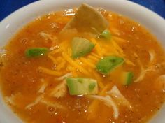Chicken Lime Tortilla Soup.  .  Chicken broth flavoured with salsa and lime,poured over tortilla chips and shredded chicken and garnished with cheese and avocado.