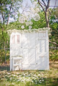 Great backdrop for a wedding! Old doors can easily be found at second-hand or antique stores.
